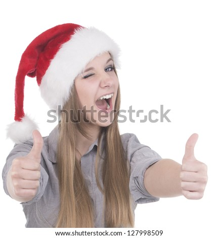 Young  woman in santa hat winking - stock photo