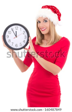young woman in santa hat with clock posing isolated on white background - stock photo