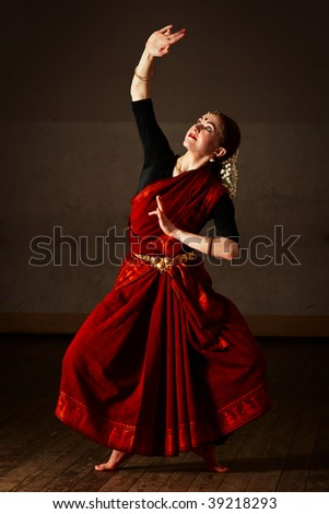 Young woman in sary dancing classical traditional indian dance Bharat Natyam - stock photo