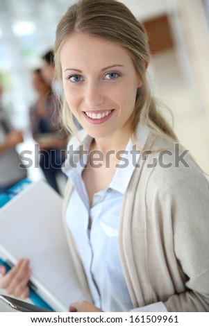 Young woman in school campus using smartphone
