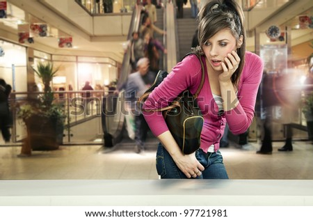 Young woman in shopping center - stock photo