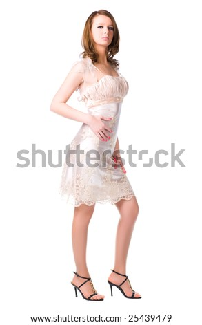 Young woman in silver dress. Isolated on white. - stock photo