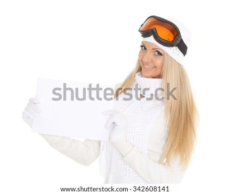 Young  woman in ski glasses and  winter warm clothes with empty board for the text on a white background. Winter sports. - stock photo