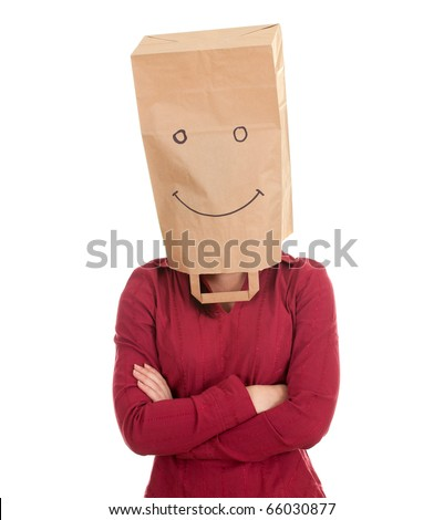 young woman in smiling ecological paper bag on head and crossed arms