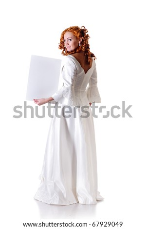 young woman in snowy wedding dress show blank frame - stock photo
