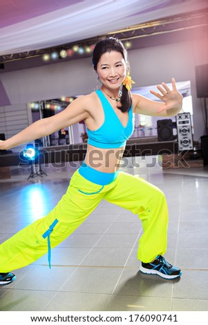 young woman in sport dress at an aerobic class - stock photo