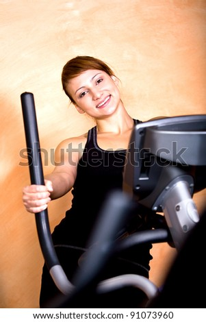 young woman in sport dress at the gym