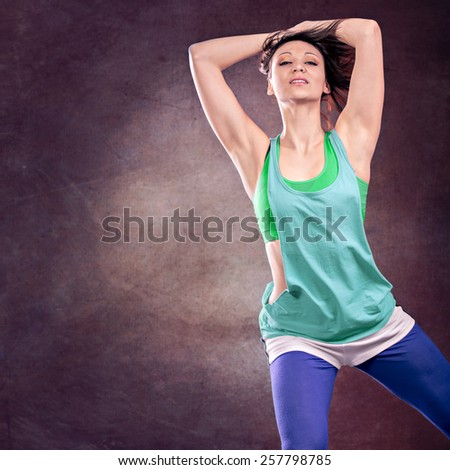 young woman in sport dress dancing aerobics - stock photo