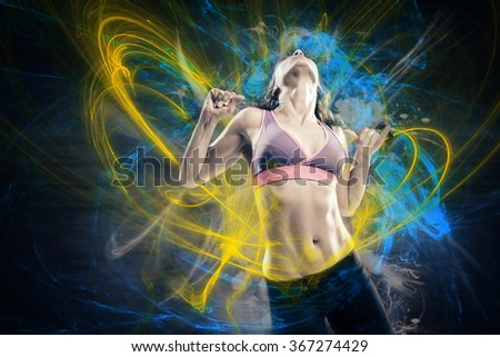 young woman in sport dress dancing in reggaeton or hiphop style