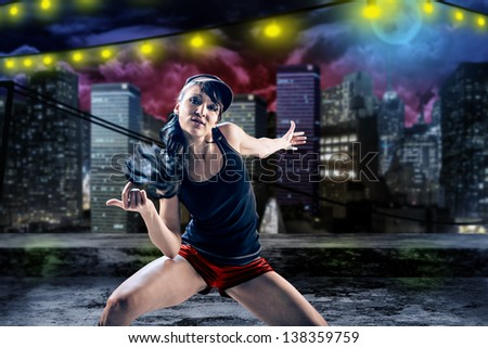 young woman in sport dress dancing in zumba or reggaeton or hiphop style - stock photo