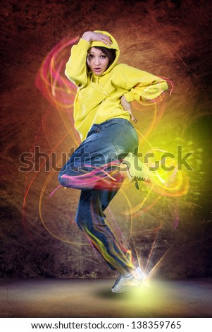 young woman in sport dress dancing zumba - stock photo