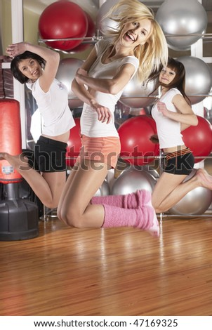 Young woman in sport training at fitness center - stock photo