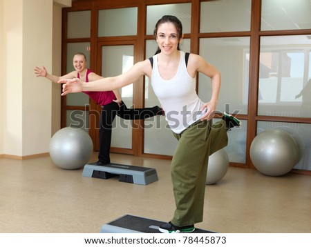 young woman in sport wear exercising in sport club