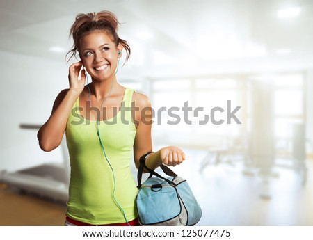 Young Woman in sport wear walking in gym - stock photo