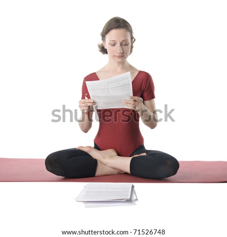 Young woman in sports clothes working with documents - stock photo