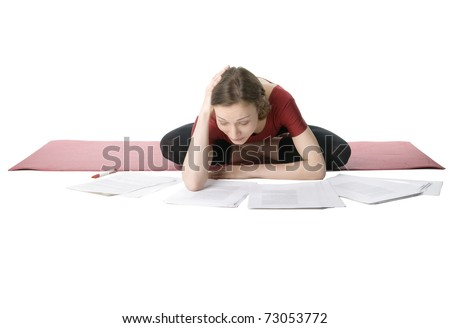 Young woman in sports clothes working with documents