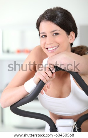 Young woman in sports room - stock photo