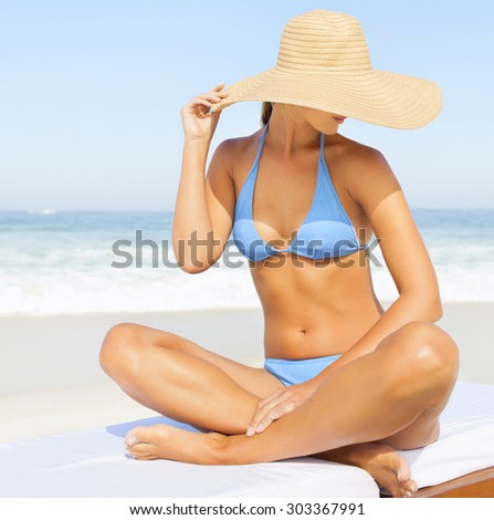 young woman in straw hat on tropical beach - stock photo