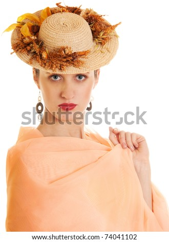 Young woman in straw hat with dry flowers