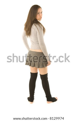 Young woman in sweater and skirt on white background