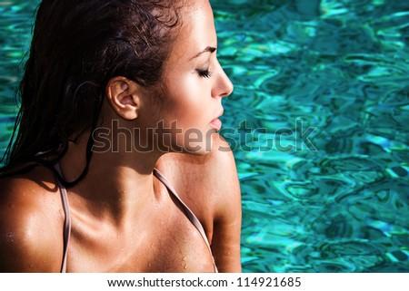 young woman in swimmingpool portrait, take sunbath, profile - stock photo