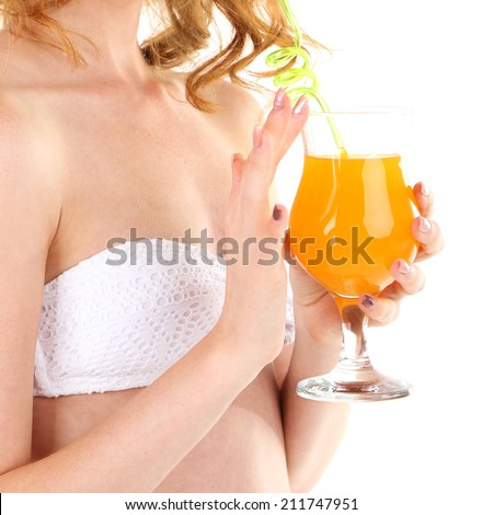 Young woman in swimsuit with cocktail isolated on white - stock photo