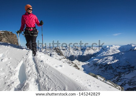 Young woman in the Alps in winter - stock photo