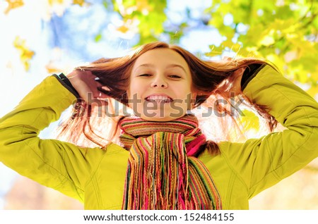 Young woman in the autumn park.