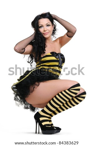 Young woman in the bee costumes on white background - stock photo