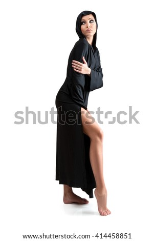 Young woman in the black mantle isolated on white background