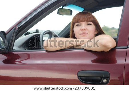 young woman in the car portrait - stock photo