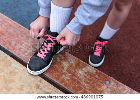 Young woman in the city getting ready for a run
