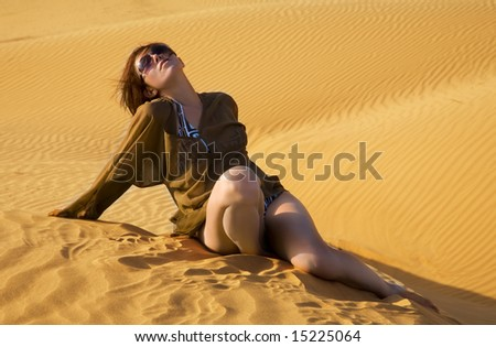 Young woman in the desert - stock photo