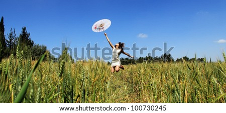Young woman in the field - stock photo