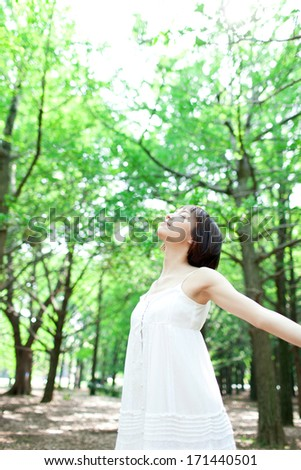 young woman in the forest - stock photo