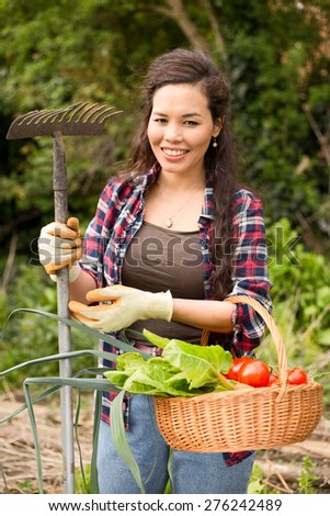 young woman in the garden - stock photo