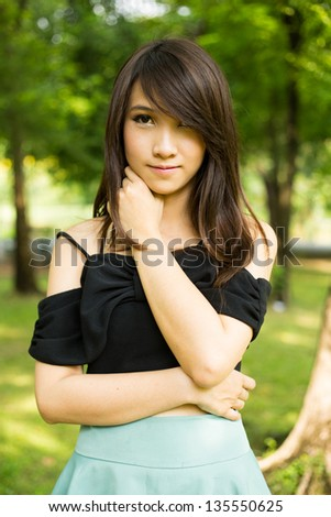 Young woman in the green park - stock photo