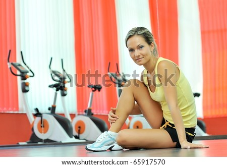 young woman in the gym - stock photo