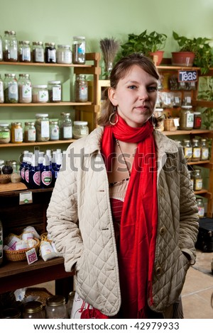 Young woman in the herb store