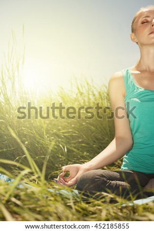 Young woman in the lotus posture close up nature photo - stock photo