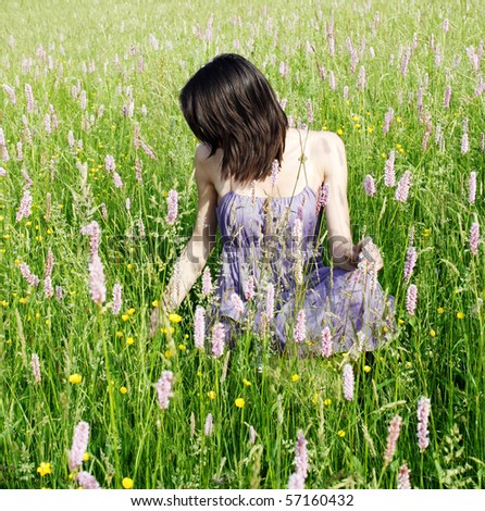 Young woman in the meadow - stock photo