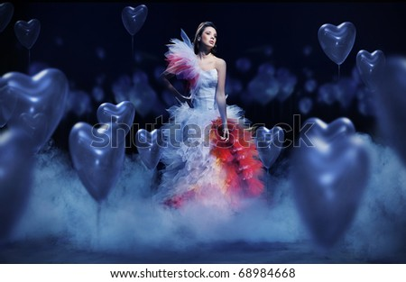 Young woman in the mist with hearts - stock photo