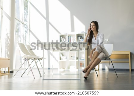 Young woman in the office - stock photo