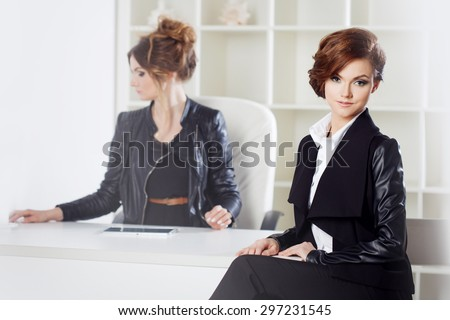 Young woman in the office with a colleague
