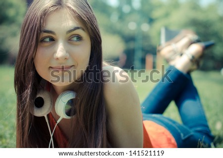 young woman in the park in spring - stock photo
