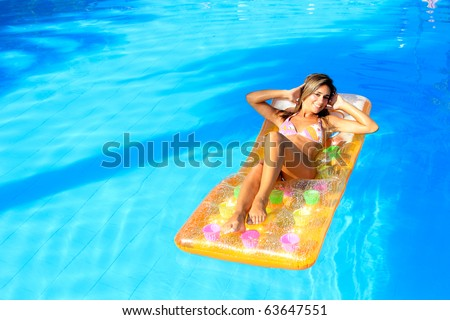 Young woman in the pool in greece - stock photo