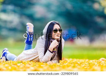 Young woman in the rays of the autumn sun - stock photo