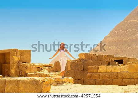 Young woman in the ruins of the Egyptian pyramids. - stock photo