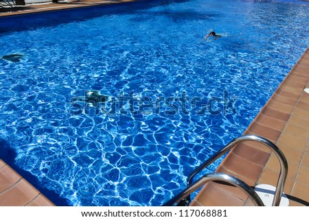 Young woman in the swimming pool - stock photo