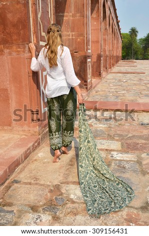 Young woman in the traditional Indian punjabi dress at Humayun's Tomb. Delhi, India - stock photo